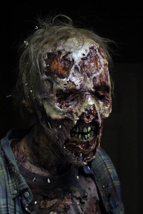 A-close-up-of-a-walker-in-season-6-of-AMCs-The-Walking-Dead-467x700